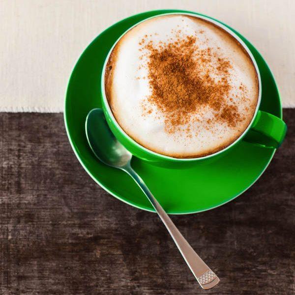 Caffeinated Kiwi coffee cup